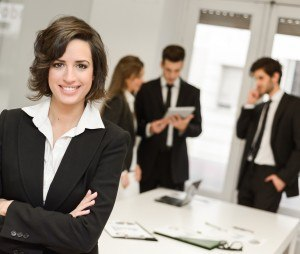 Image of businesswoman leader looking at camera in working environment