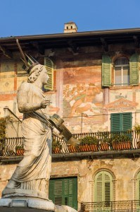 The ancient roman statue called Madonna Verona on a fountain in Piazza delle Erbe in Verona,